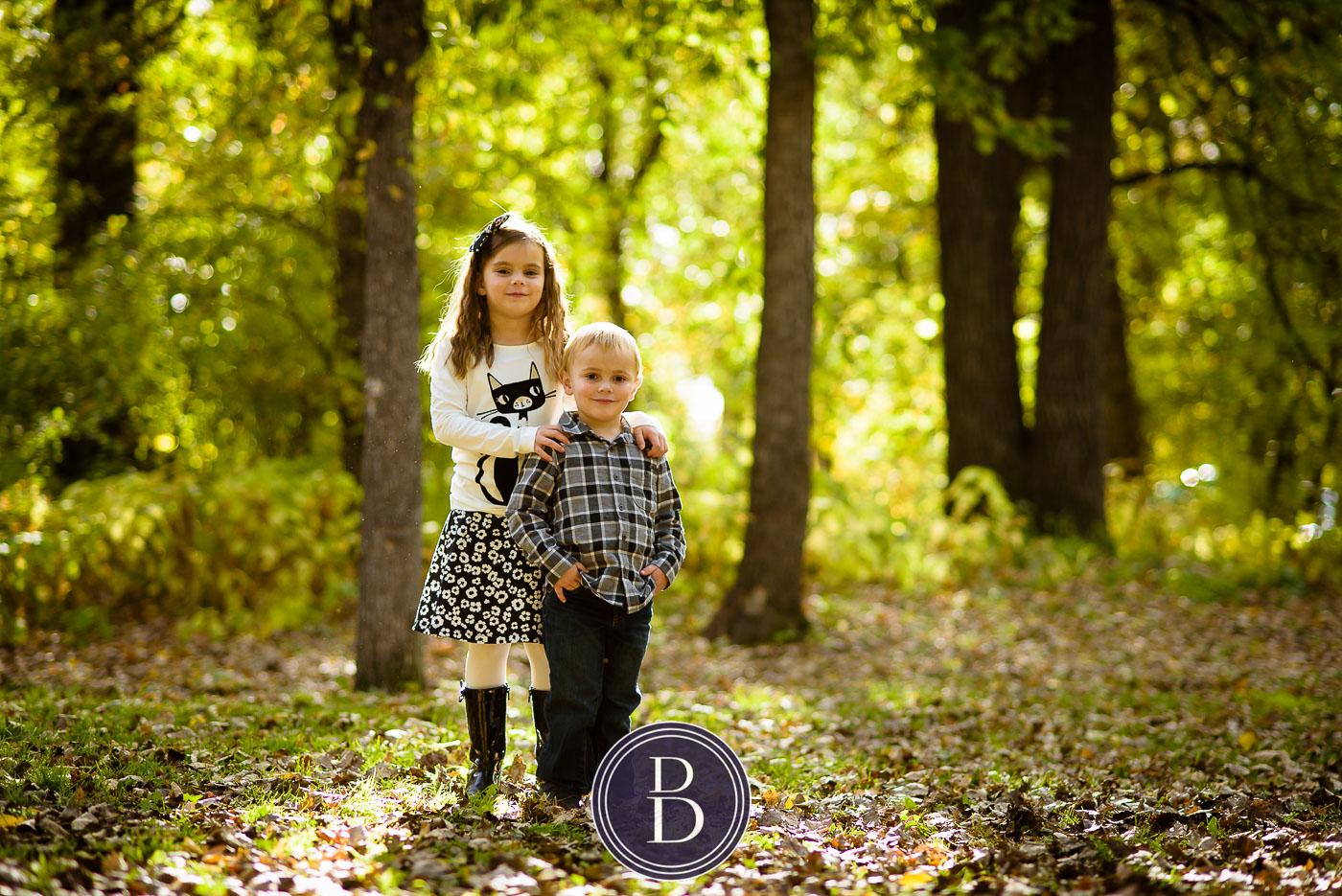 fall portrait of family at kildonan park boy and girl