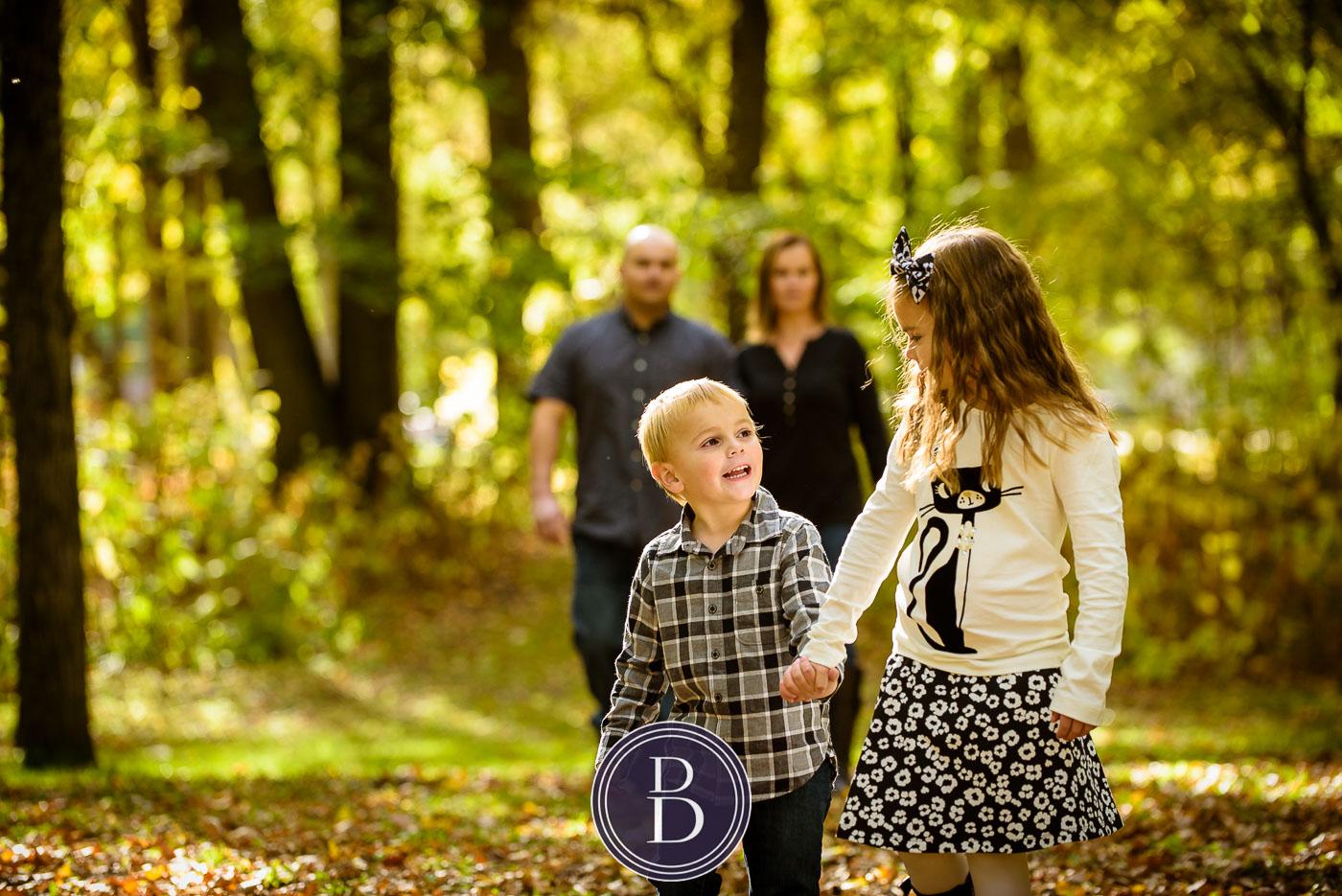 cute fall portrait of family at kildonan park