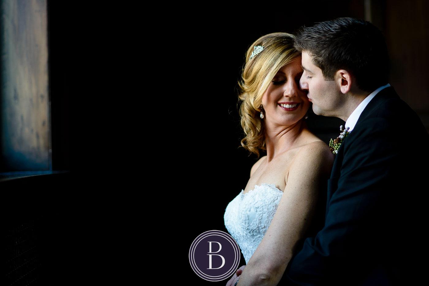 Romantic kiss bride groom Hamilton building