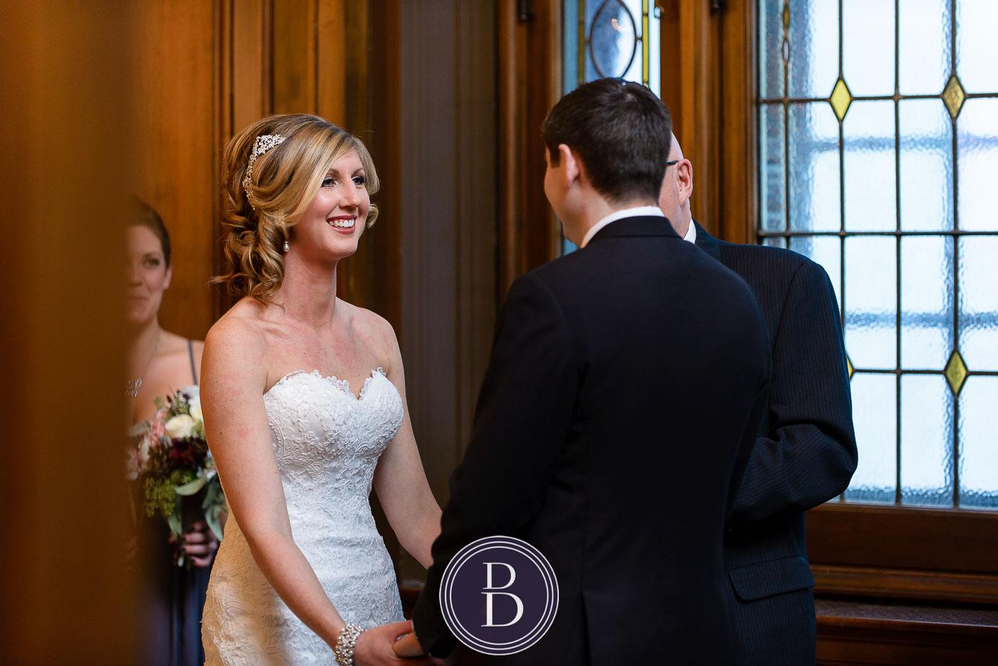 Winnipeg winter wedding ceremony bride smiles