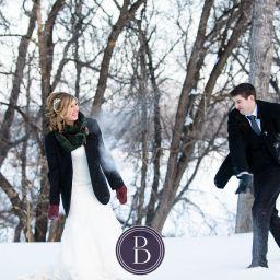 Winnipeg winter wedding snowball fight bride and groom