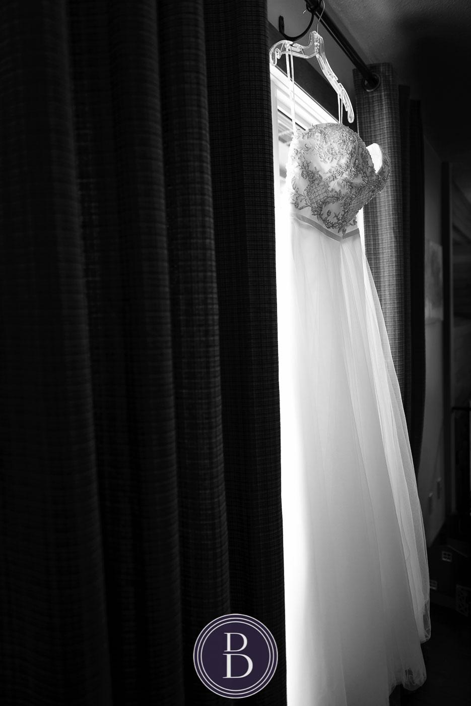 Brides dress on window