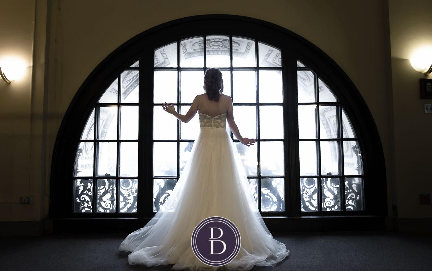 Bride by large window Hamilton Building