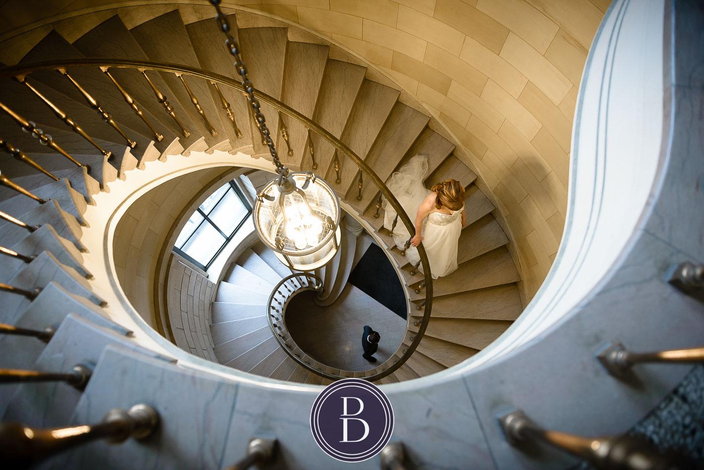 Bride walking down stairs first look