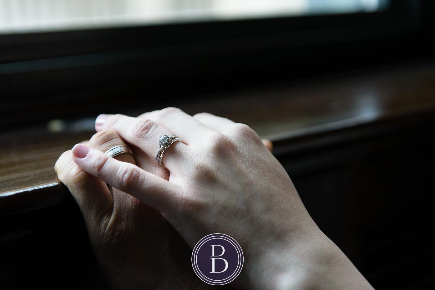wedding bands holding hands