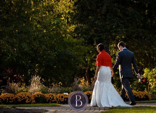 Winnipeg wedding photos portrait bride and groom holding hands walking at Assiniboine Park