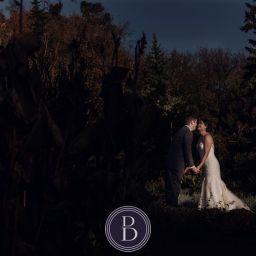 Winnipeg wedding photos portrait bride and groom going to kiss at Assiniboine Park