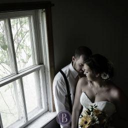 Wedding bride groom indoor window portrait