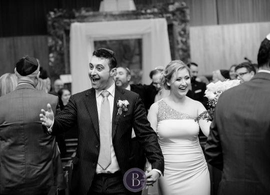 Fairmont Winnipeg Wedding Photos by Derek Bogdan Photography Jewish wedding ceremony at Shaarey Zedek bride and groom smiles