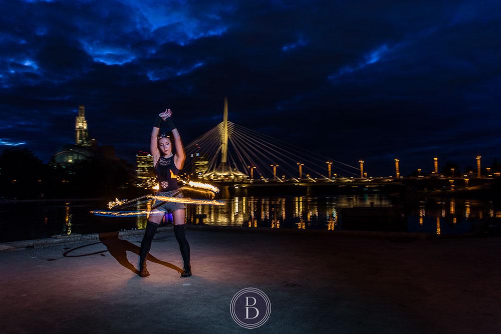 hoola hoop dancing in evening by Red River