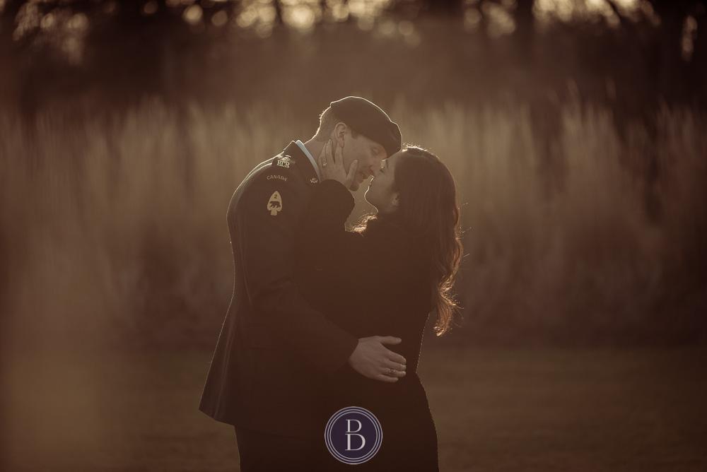 Engaged Winnipeg couple close to kissing sunset Assiniboine Park