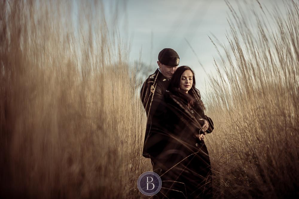 Engaged couple hugging in love tall prairie grass Assiniboine park