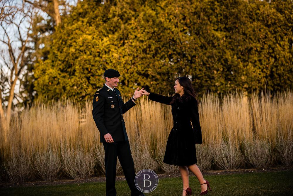 Engaged couple dancing fall sunset portrait Assiniboine park