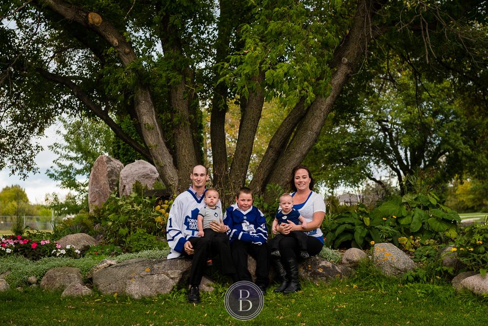 engaged couple family photo hockey jerseys