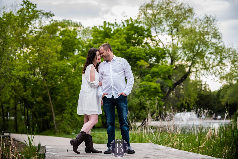 Assiniboine Park Engagement Photos couple holding tight