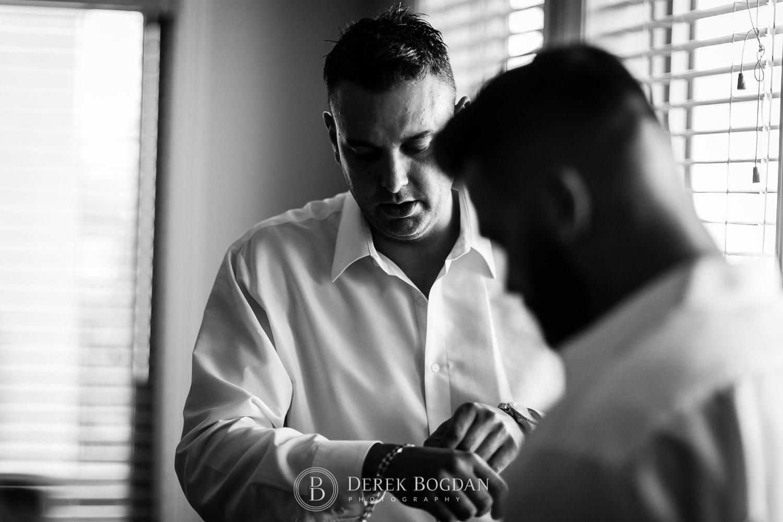Wedding day groom getting dressed