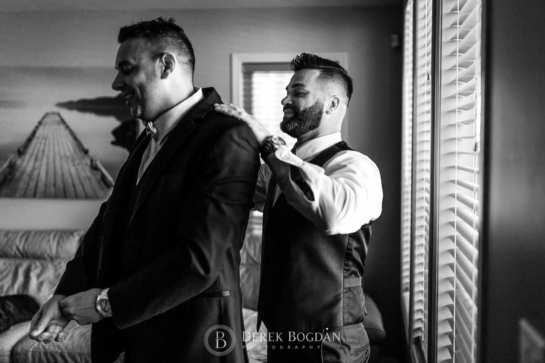 Groom getting dressed Winnipeg wedding