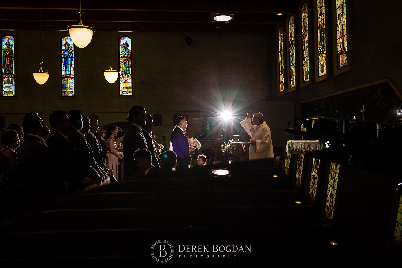 dramatic portrait catholic wedding ceremony Winnipeg