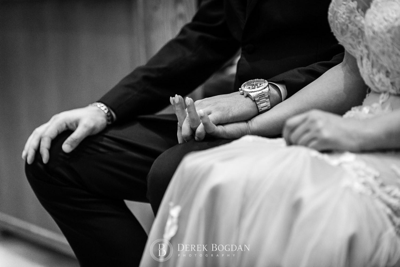 hands bride and groom at church Winnipeg