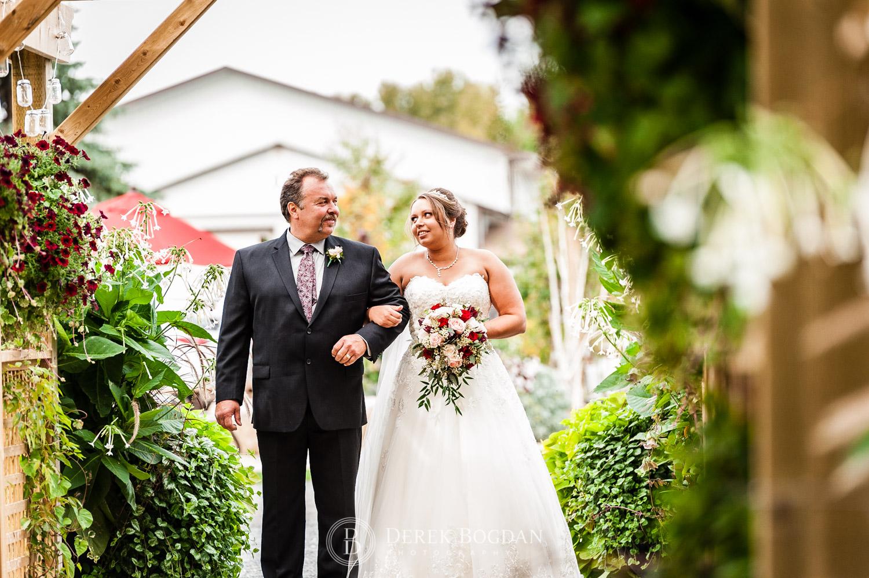 ceremony bride with dad outdoor ceremony