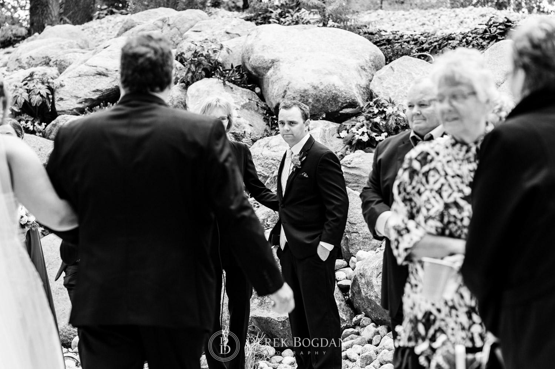 groom looks on wedding ceremony