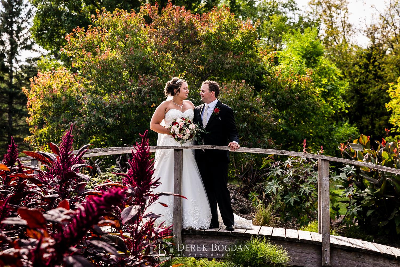 bride and groom outdoor portrait on bridge