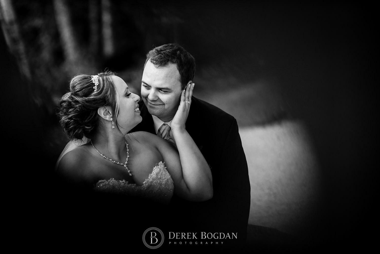 Bride and groom creative outdoor portrait
