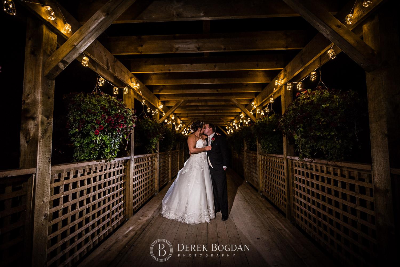 bride and groom kiss evening outdoor wedding