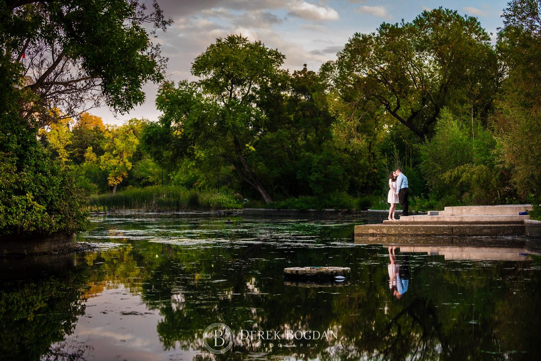 Evening engagement kiss by pond Assiniboine park Winnipeg top photographer
