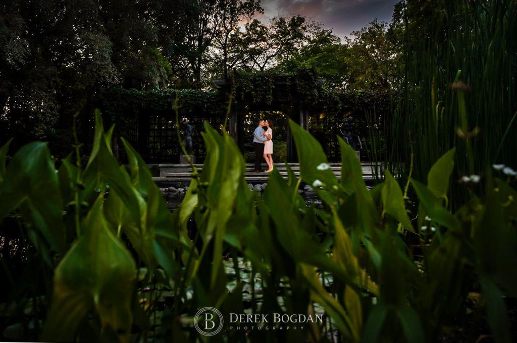 Evening engagement photo Leo Mol Garden Winnipeg Assiniboine Park top wedding photographer