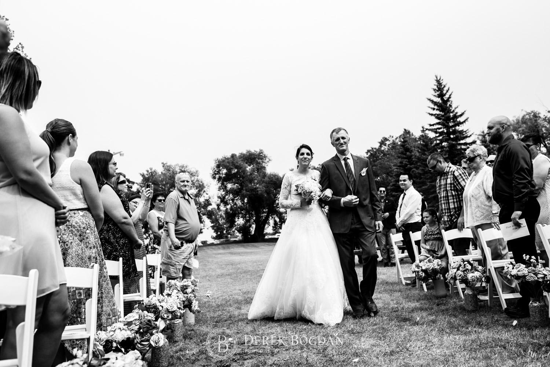 bride with dad walking outdoor ceremony Manitoba