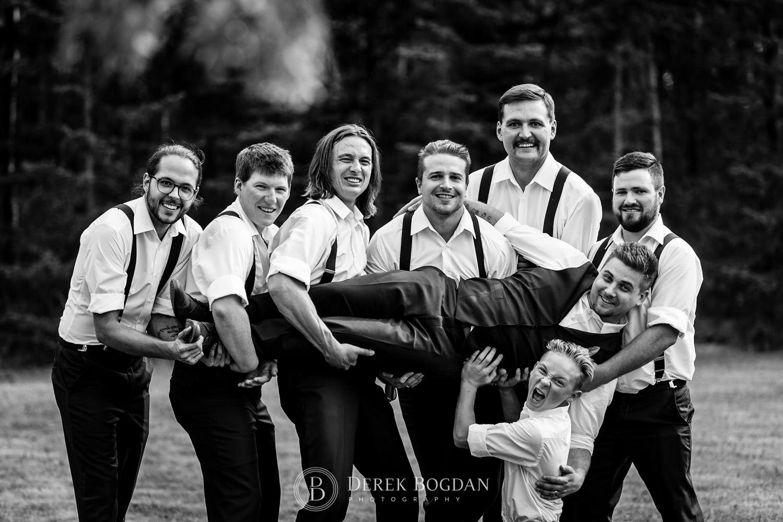 boys having fun outdoor ceremony Manitoba wedding