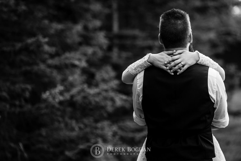 bride holding her groom outdoor ceremony Manitoba wedding