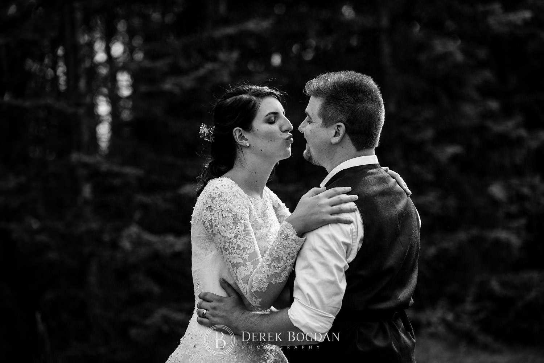 bride with a kiss outdoor ceremony Manitoba wedding