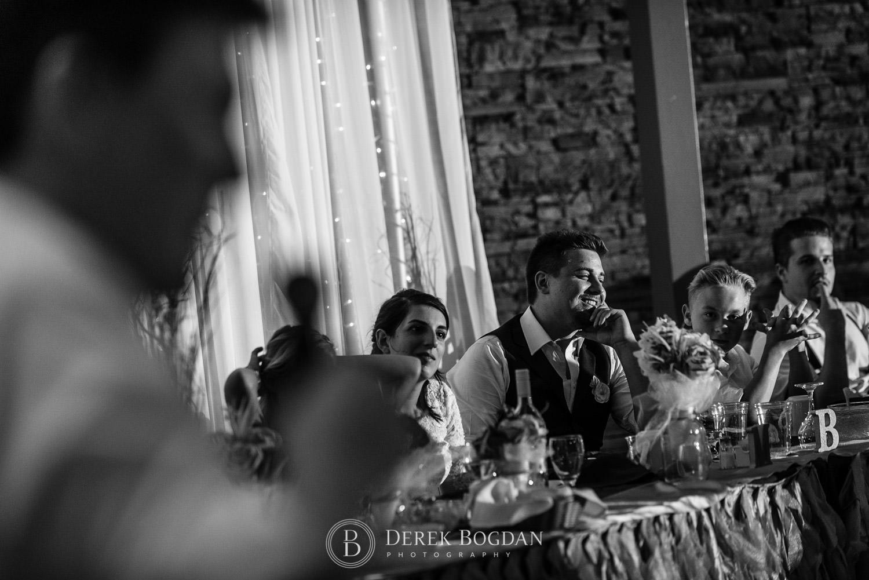 Laughter at head table Manitoba wedding