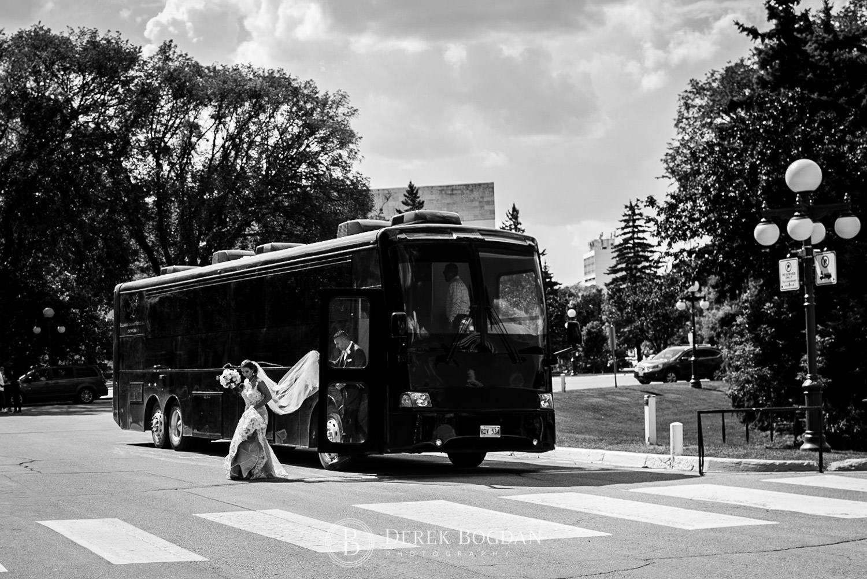 bride and groom by limo bus Winnipeg wedding photo