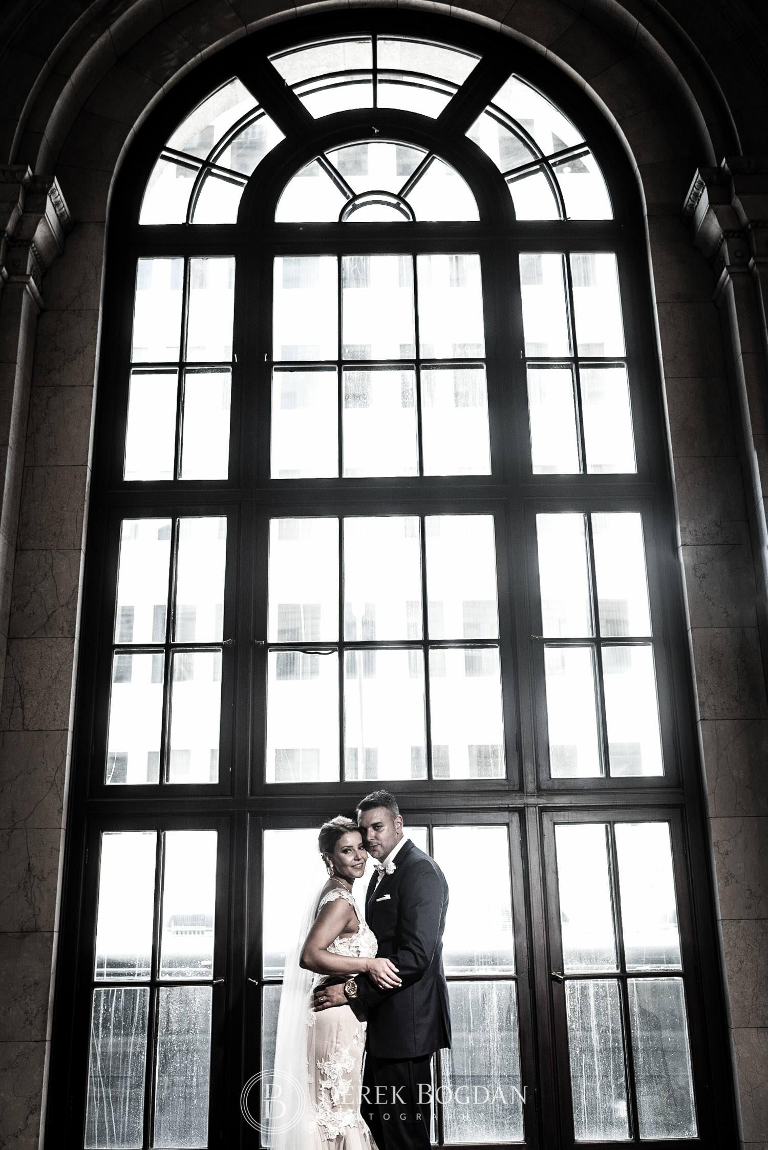 window wedding portrait of couple Winnipeg wedding photographer