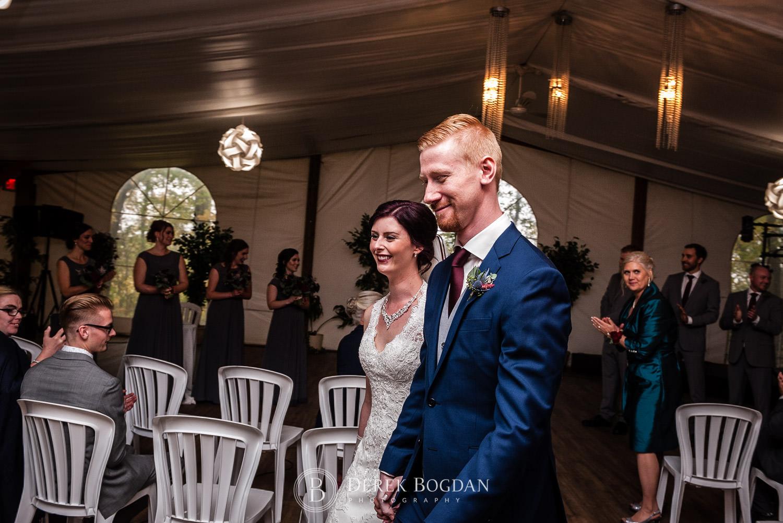 bride groom post ceremony recessional Evergreen Village Wedding Niverville Manitoba