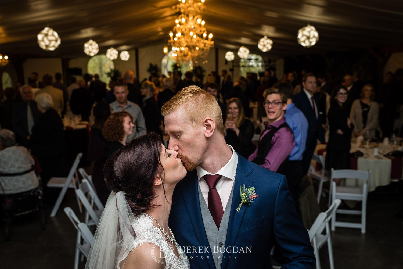 bride groom post ceremony kiss Evergreen Village Wedding Niverville Manitoba