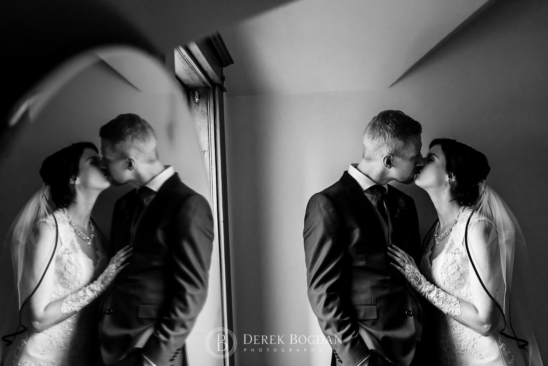 bride groom kiss reflection Evergreen Village Wedding Niverville Manitoba