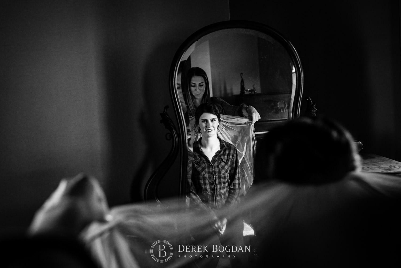 bride in front mirror veil test Evergreen Village Wedding Niverville Manitoba