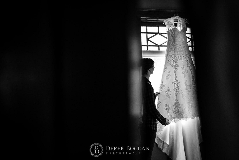 bride dress hanging window Evergreen Village Wedding Niverville Manitoba