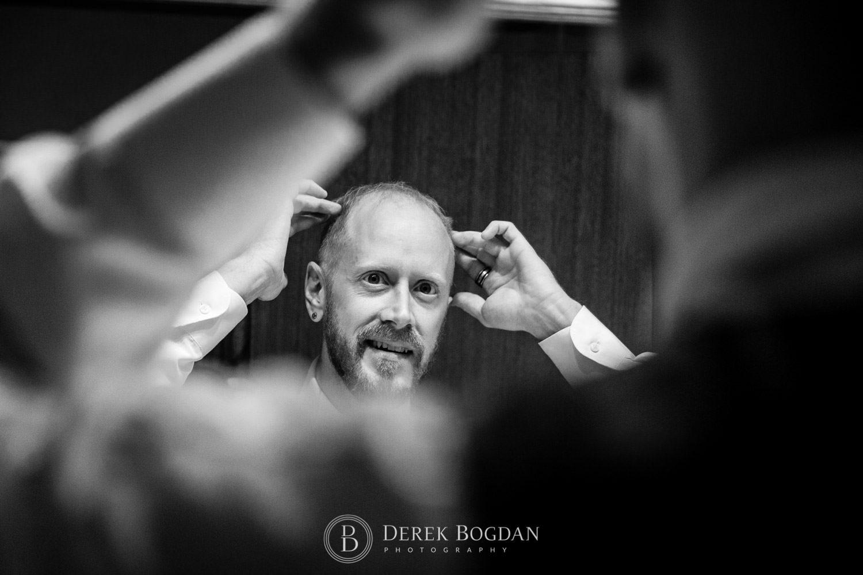 Bel Acres Golf wedding Manitoba groom getting ready bathroom mirror