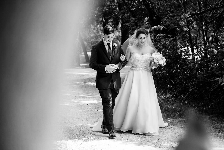 Bel Acres Golf wedding Manitoba bride walking down aisle with son outdoor ceremony