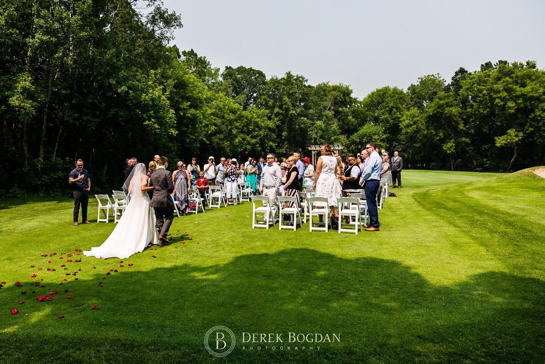 Bel Acres Golf wedding Manitoba bride walking down aisle outdoor ceremony