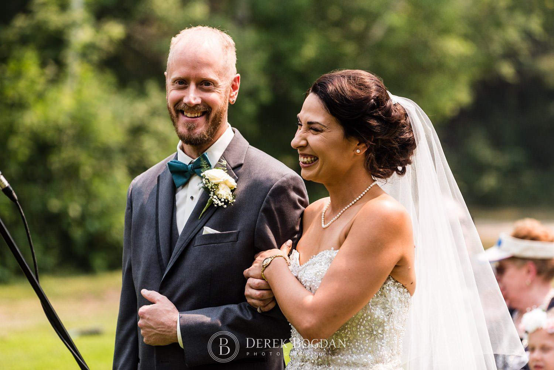 Bel Acres Golf wedding Manitoba bride and groom smiles during ceremony