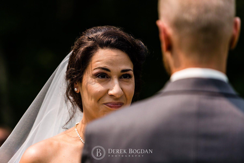 Bel Acres Golf wedding Manitoba ceremony bride looking at groom