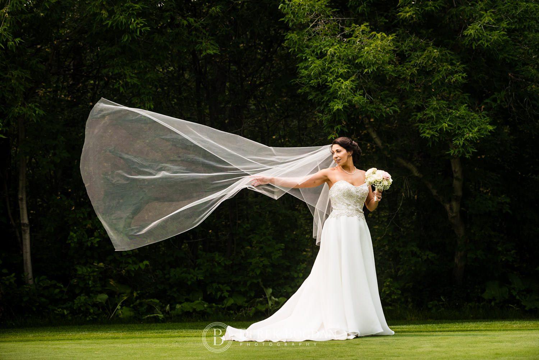 Bel Acres Golf wedding Manitoba bride and veil in wind