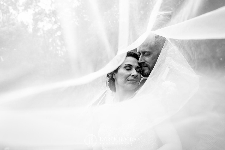 groom and bride veil portrait Bel Acres Golf wedding Manitoba