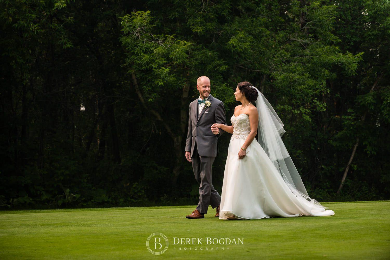 Newlyweds portrait on golf green Bel Acres Golf wedding Manitoba